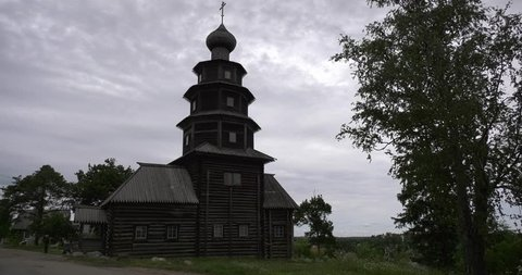 4K cloudy summer day video of Ascension Church, the only wooden cathedral on banks of Tvertsa River in small vintage town Torzhok in Tver Oblast, half way between Moscow and Saint Petersburg, Russia