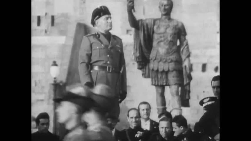 CIRCA 1950s - Mussolini is surrounded by fascist military members in the 1940s during the WWII.