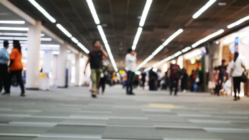 People walk in airport blur timelapse