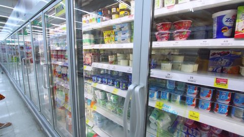 """PHUKET, THAILAND - JANUARY 3, 2017:  Refrigerators with dairy and frozen products in a """"Tesco"""" hypermarket. Tesco plc is a British multinational grocerie."""