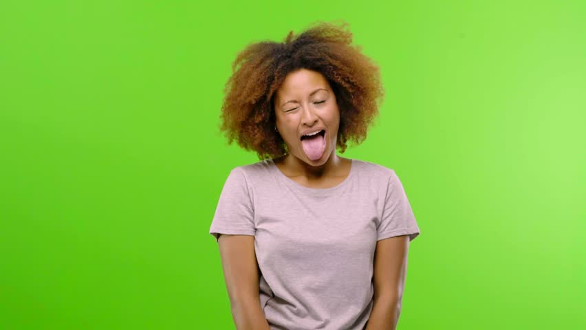 Young afro american woman expression of confidence and emotion, fun and friendly, showing tongue as a sign of play or fun | Shutterstock HD Video #1016760967