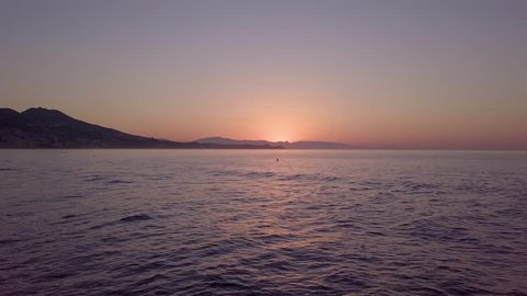 Beginning of sunrise over sea near spanish coastal city - still shot