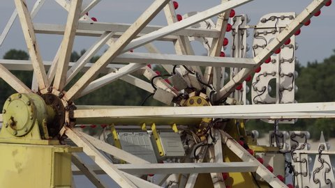 Ferris wheel close-up. Old attraction. Rotating metal structure
