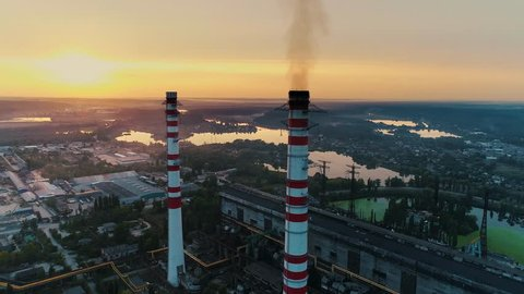 Aerial drone footage. Coal fire power station at sunset.