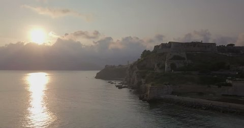 Aerial view from the sea of the fortress and the lighthouse of Portoferraio at dawn, Elba Island (Italy)