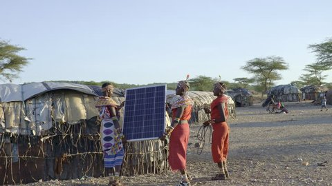 Tribal women installing solar panel. Kenya