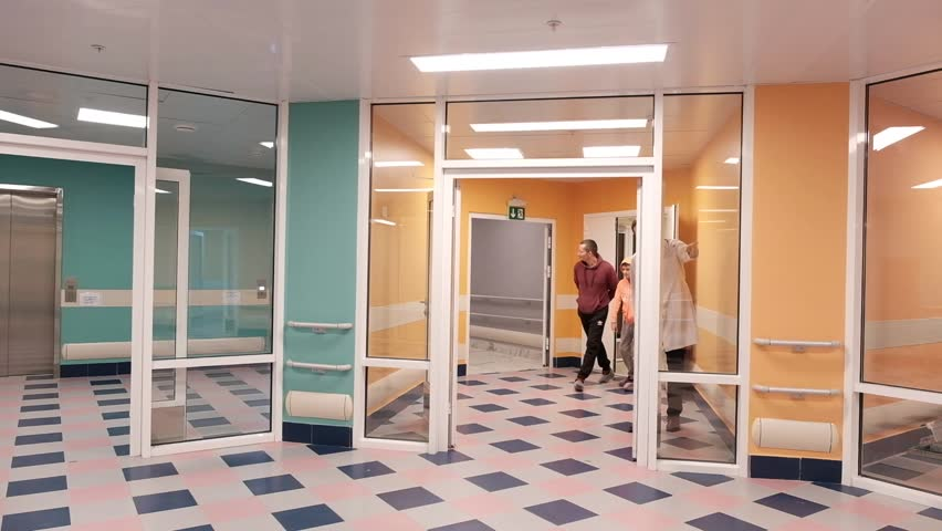 The doctor explains to patients how to find the way in the hospital lobby. | Shutterstock HD Video #1016862097