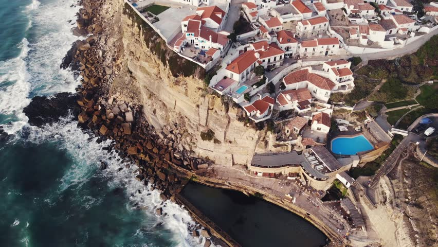 Aerial view of Azenhas Do Mar, municipality of Sintra, a seaside village on the Portuguese coast northwest of Lisbon, Portugal, shot from drone, with Atlantic Ocean view  | Shutterstock HD Video #1016892817