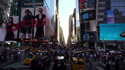 NEW YORK CITY, USA - SEPT 10, 2018:  rush hour traffic view of iconic nyc street crossing with skyscrapers with ads billboards in New York City Manhattan, USA. NYC is a popular tourist travel destinat