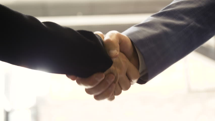 Close up of business man and woman shaking hands on deal greetings.  | Shutterstock HD Video #1017021277