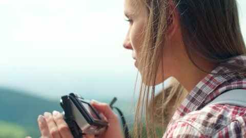 Side view of  woman taking a photo