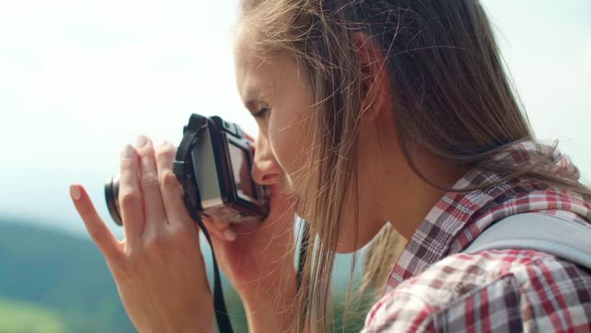 Side view of  woman taking a photo | Shutterstock HD Video #1017037327