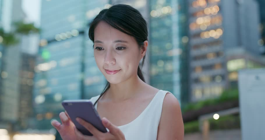 Woman use of mobile phone at night | Shutterstock HD Video #1017045547