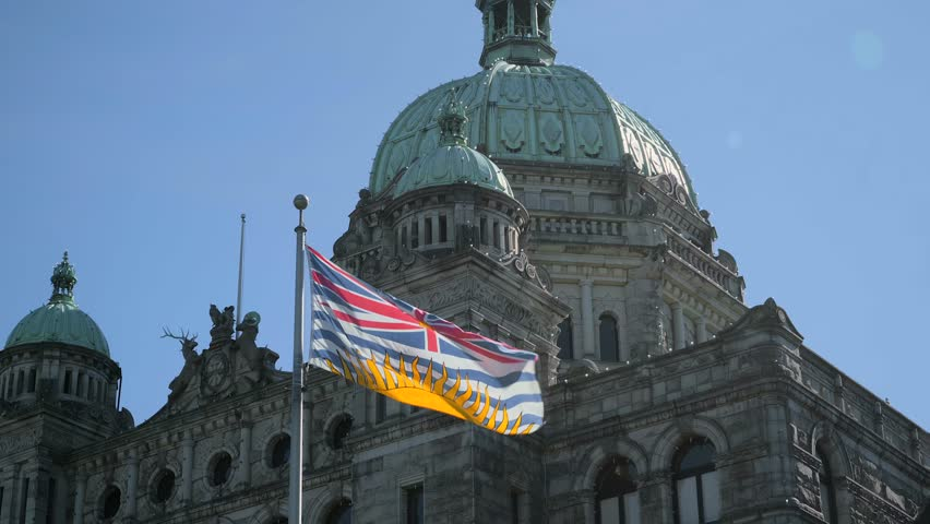 Provincial Flag at the BC Parliament Building in Victoria on Vancouver Island, British Columbia, Canada | Shutterstock HD Video #1017072487
