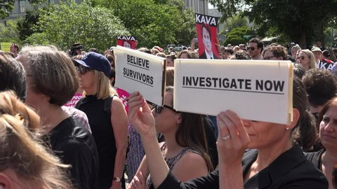WASHINGTON, DC - SEPT 28, 2018: Rally at Supreme Court against Bret Kavanaugh nomination for associate justice. Investigate now. Believe survivors signs, pan to Sen Gillibrand.