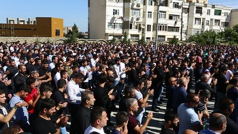 Baku, Azerbaijan - 20 SEP 2018: Crowds of Azeri men have gathered to take part in a sombre parade to commemorate the martyrdom of Hussain, as part of Ashura and Muharram, in Baku