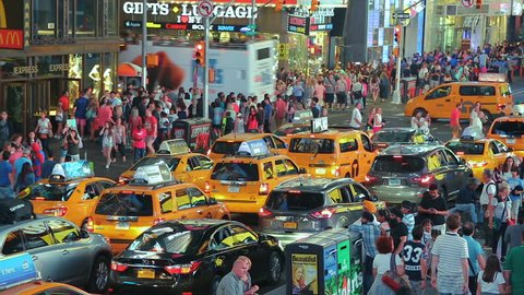 New York, United States - jun 22, 2016: New york city yellow taxi cabs times square. Times Square New York City. View of New York yellow taxi traffic driving under colourful neon lights Times Square.