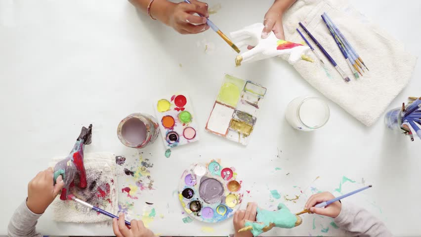 Step by step. Little girls painting paper mache unicorn with acrylic paint. | Shutterstock HD Video #1017209677