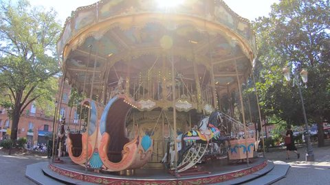 Classical French Carousel In Park, Jardin Pierre Goudouli, Spinning Around on A Bright Sunny Day, Toulouse, France