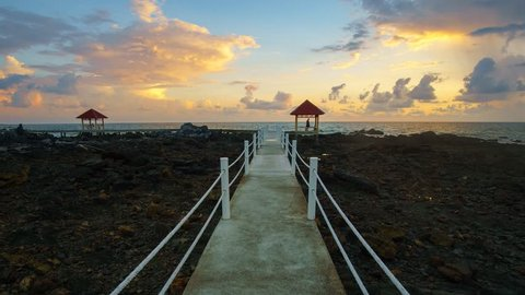 Timelapse of colourful sunrise at Tanjung Balau jetty. New walking path been build to ease tourist enjoy the scenery. Tanjung Balau is fishing hub at Johor, Malaysia. Camera tilt down