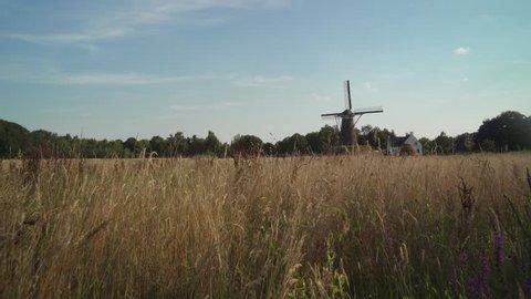 Traditional Windmill in Van Gogh Village Nuenen in Noord-Brabant The Netherlands - Slider / Wide Shot -