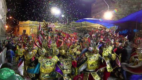 Oruro village carnival parade ceremonial dancing. Colorful Bolivian folklore parade with Tinkus dancing and parading. Masterpiece of the Oral and Intangible Heritage of Humanity by Unesco.