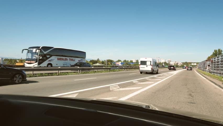 STRASBOURG HOENHEIM, FRANCE - CIRCA 2018: Driver POV at cars driving enters Autoroute de l'Est highway with heavy traffic leaving Strasbourg toward Paris 4k uhd footage of French autoroute