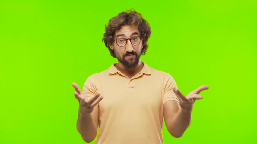 Young bearded silly man speaking front against chroma key editable background. ready to cut out the person.