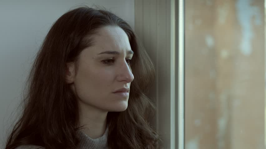 Depressed lonely younng woman crying at window.Sadness,broken heart | Shutterstock HD Video #1017472297