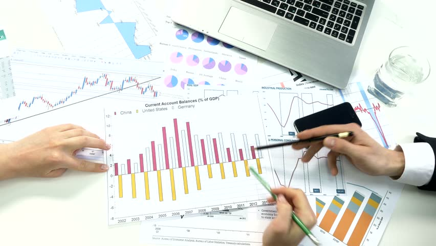 Business peoples developing a business project and analyzing market data information. | Shutterstock HD Video #10174877