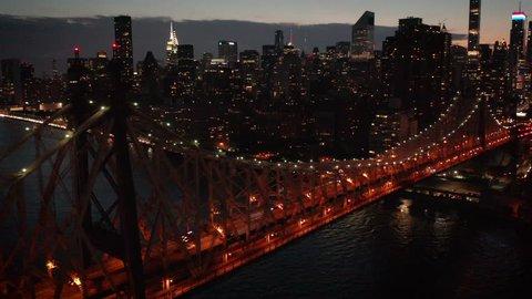 dusk orbiting Queensboro Bridge from NYC to LIC