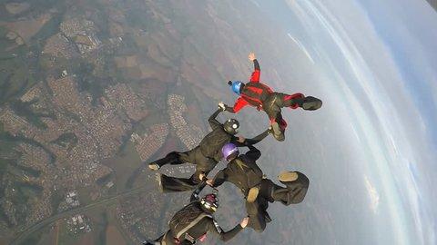 Boituva, São Paulo Brazil on October 6, 2018: A team of 4 professional parachutists jump from parachute