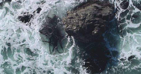 Aerial over waves crashing on rocks. Big Bur, California. California, USA.