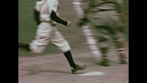 1930s: Babe Ruth swings at ball. Baseball players run for bases and walk across field.