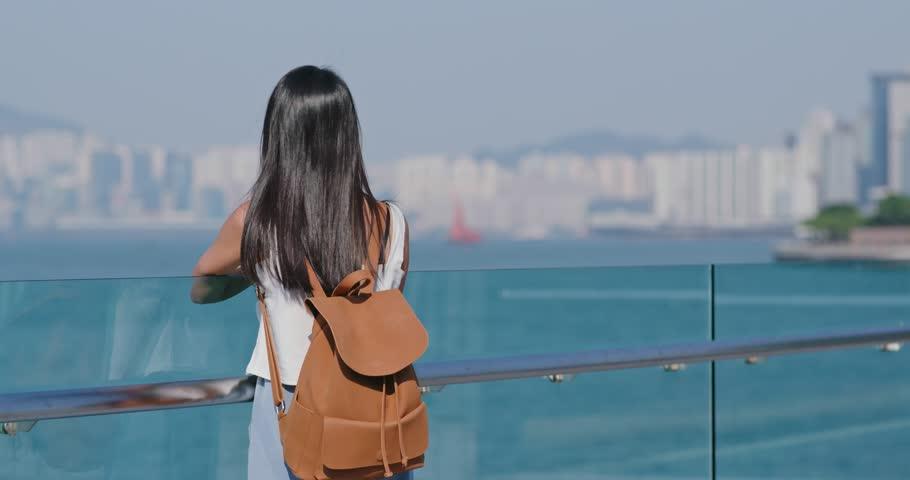 Woman enjoy the sea view in Hong Kong   Shutterstock HD Video #1017582637