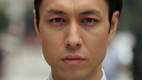 Asian man in city serious face portrait