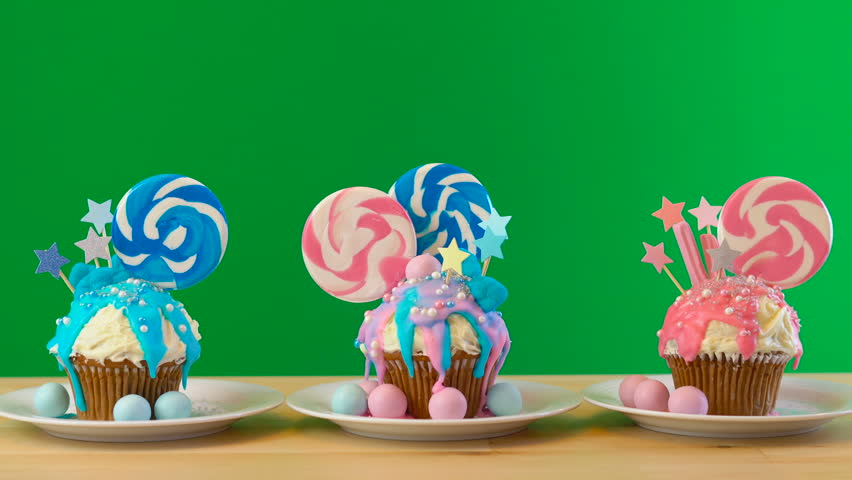 Pink and blue theme colorful novelty cupcakes decorated with candy and large lollipop for children's, teen's birthday, Valentine's or party celebrations, on removable chroma key background.. | Shutterstock HD Video #1017633907