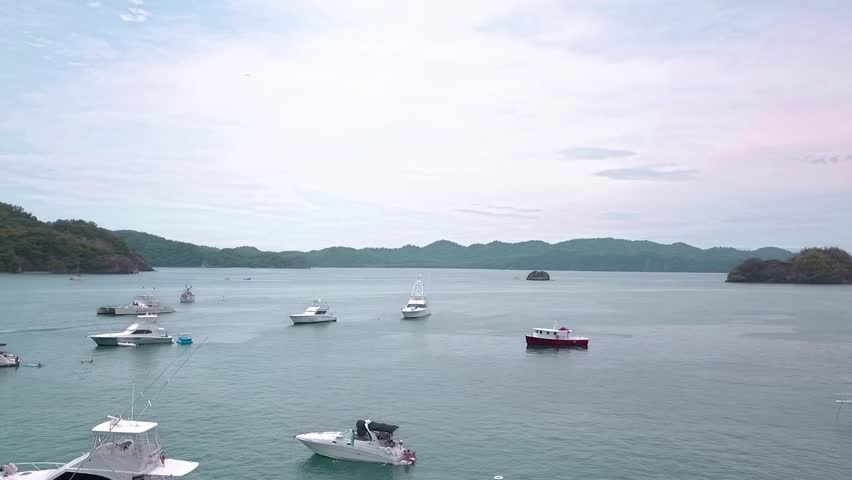 Boats anchored next to Tortuga Island in Costa Rica. | Shutterstock HD Video #1017645037
