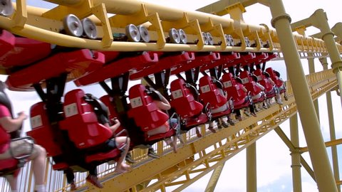 Inverted roller coaster climbing first hill