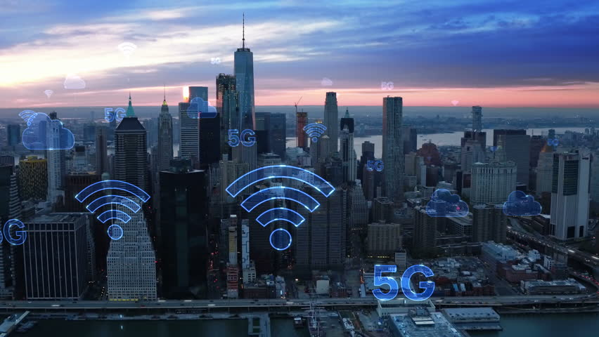 Aerial city connected through 5G. Wireless network, mobile technology concept, data communication, cloud computing, artificial intelligence, internet of things. New York City skyline. Futuristic city | Shutterstock HD Video #1017726757