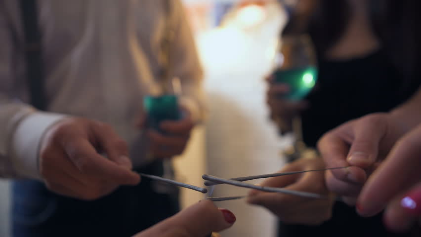 Group of friends having fun with sparklers and beverages at Halloween party | Shutterstock HD Video #1017734647