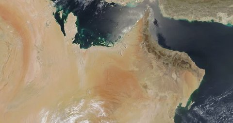 Very high-altitude overflight aerial of Persian Gulf, Gulf of Oman and surrounding land . Clip loops and is reversible. Elements of this image furnished by NASA