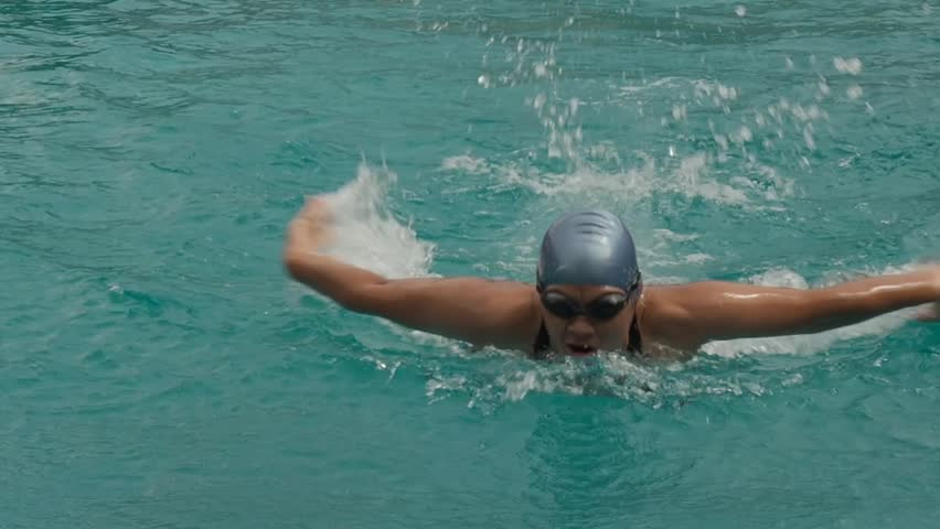 Professional woman swimmer Training The Butterfly Stroke in the Pool.Slow Motion Shot #1017812587