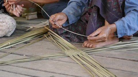 Chiang mai, thailand – august 5, 2018: thai traditional handicraftsman  weaving carp fish craft