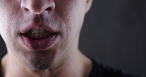 Close up mouth of Angry Man screaming. Danger Violence. 4K 10-bit