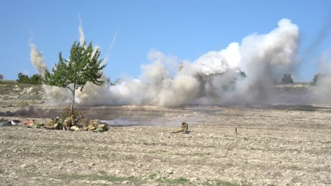 Pervomayka / Russia - september 16 2018: Russian troops against Arabic opposition groups. War. Battlefield. Explosions. Shooting