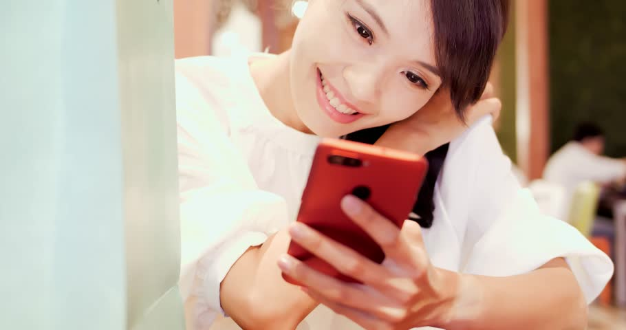 Woman use phone happily in the shopping mall | Shutterstock HD Video #1018090597
