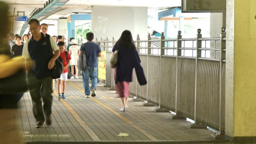 Timelapse of people moving along walk way in Hong Kong. | Shutterstock HD Video #1018164577