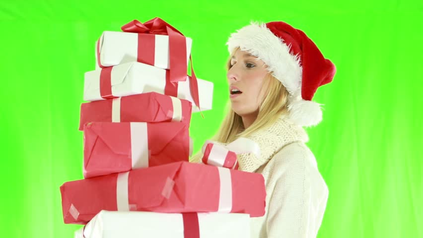 Busy Christmas shopping-Woman falling with presents. Green screen | Shutterstock HD Video #1018174957