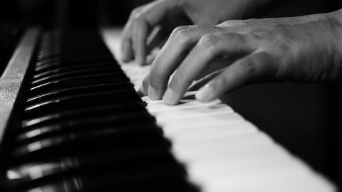 4K footage of piano music pianist hands playing monochrome black and white color. musical instrument grand piano selective focus with depth of field